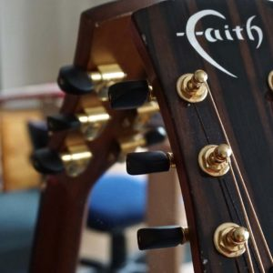 guitar leaning against a mirror