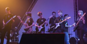 Children performing with Richard at The Rock Project concert.