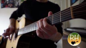 Richard Hunt playing acoustic guitar.
