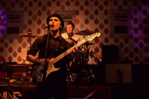 Simon Campbell playing guitar